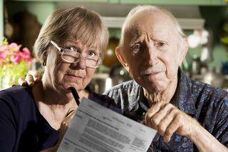 Bigstock-Elder-Couple-With-Bills-3557267